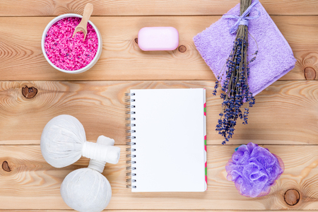 lavender theme: a clean sheet of notepad and objects with lavender for spa and relaxation