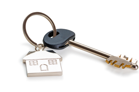 key with a key fob in the form of a house on a white background is isolated