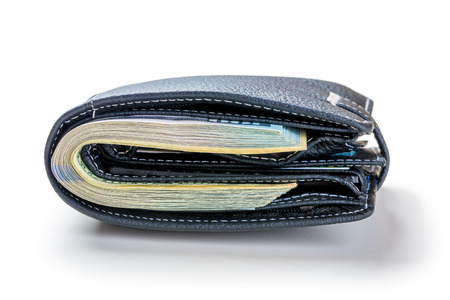 Tight-packed wallet with 100 dollar bills on a white background