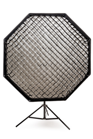 equipment flash with honeycombs with octagonal softbox on the rack in studio close-up on a white background