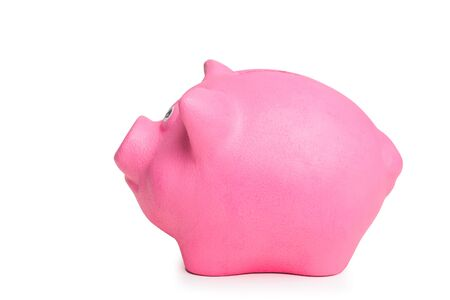 pink piggy bank isolated on white background side view close up