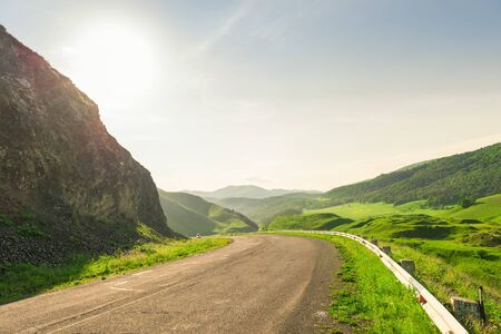 Road with dangerous turns in the mountains of Armenia sunny summer landscape