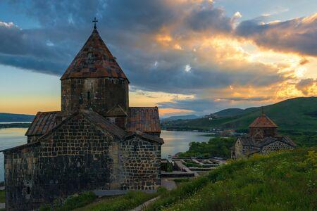 Beautiful sunset on Lake Sevan, dramatic sky over Sevanavank Monastery, Armenia Imagens