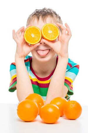 funny portrait of a boy with oranges on a white background Imagens