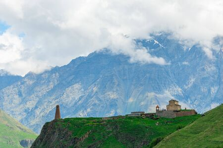 Georgian buildings on the background of high beautiful Caucasian mountains