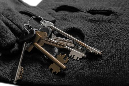 keys of the robber for opening locks, balaclava and gloves close-up