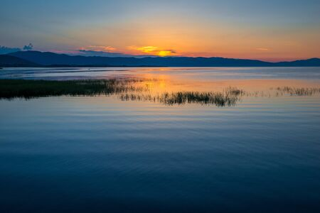 Beautiful sunrise in the early morning on Lake Sevan, Armenia