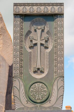 Stone Armenian khachkar with carved pattern close up