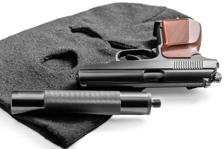 crime concept objects gangster - balaclava and gun close-up