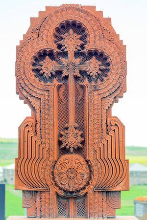 Cross stone Armenian traditional khachkar on a graveyard tombstone Imagens