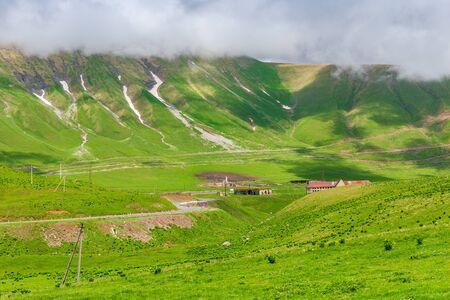 Scenic green mountains and clouds, Caucasus in June, Georgia trip
