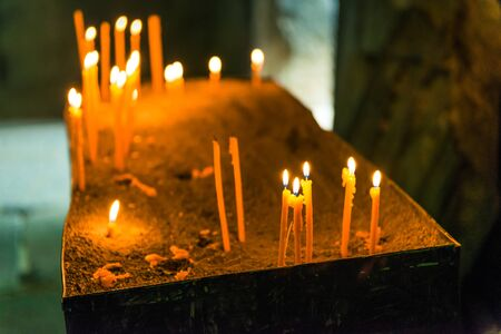 Burning candles in orthodox church close up, concept religion