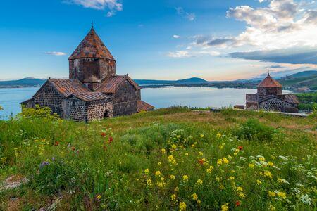 Sevanavank Monastery on Lake Sevan at sunset, Armenia Imagens