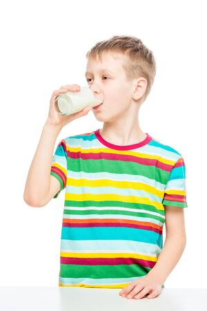 child drinks milk from a glass, portrait of a healthy boy concept photo healthy food