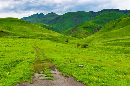 Dirt road leading to the mountains, the landscape of Armenia