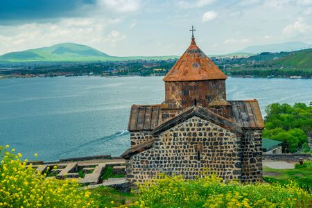 View from the hill to the monastery Sevanavank, Lake Sevan and the city of Sevan, the sights of Armenia