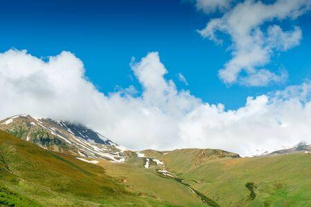Green mountains with snow caps in June, Caucasus, Georgia