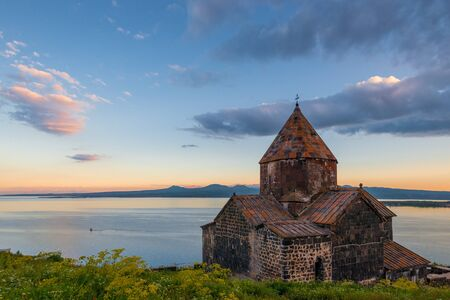 Property of Armenia famous landmark Monastery Sevanavank and Lake Sevan at sunset Imagens
