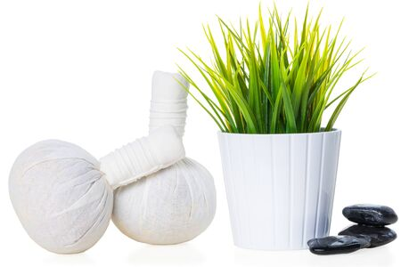 spa composition fabric massage bags, stones and plant on a white background