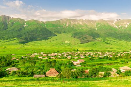 Top view of the picturesque landscapes of Armenia, high mountains and green meadows on a sunny summer day