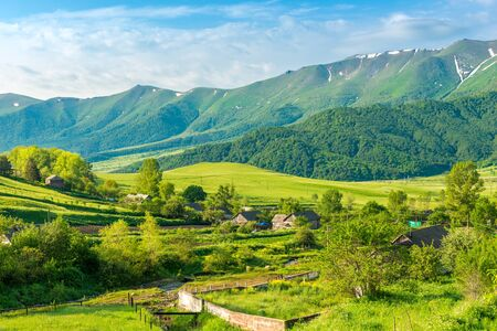View of an Armenian village in a picturesque mountain valley in early summer in June