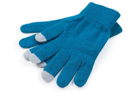 warm clothes on a white background knitted gloves on a white background is insulated