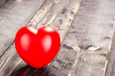 red heart on a wooden dark table close-up Stockfoto