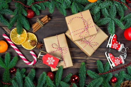 Three gifts in retro packaging on a wooden table close-up, objects Christmas concept