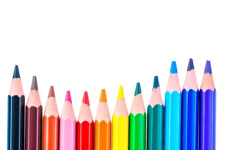 color wave concept, row of colored pencils on a white background isolated
