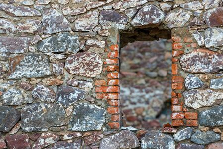 Ancient castle wall with niche window close up Stockfoto