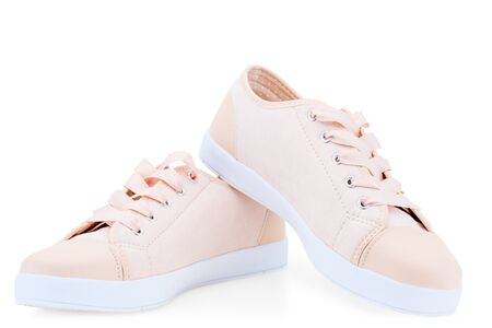 womens pink canvas canvas comfortable shoes on a white background sneakers Stockfoto