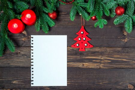 Notebook for writing greetings, New Year decorations top view greeting card closeup