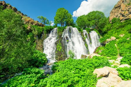 Beautiful full-flowing picturesque waterfall of Armenia Shaki