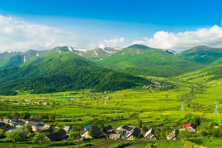 Authentic Armenian village at the foot of high mountains in Armenia Stockfoto