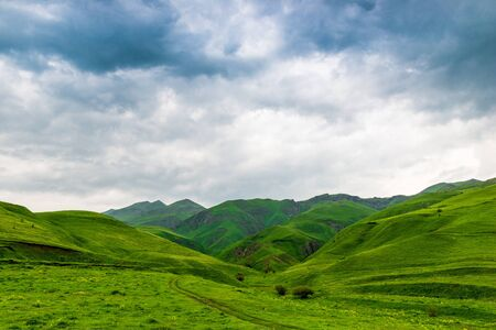 Scenic beautiful high mountains of the Caucasus, clouds over the mountains, the landscape of Armenia Stockfoto