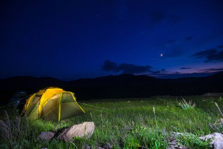 Large tent in the field under the stars, night photography, tourism concept, travel