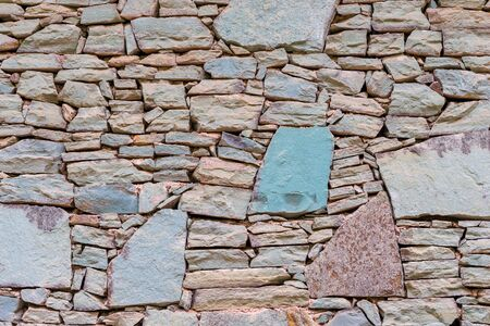 Stone wall cladding home natural stone background close up Stockfoto