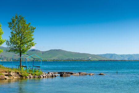 Calm beautiful lake Sevan with clear water in Armenia, a natural landmark at sunrise
