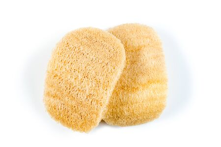 Loofah sponge close up isolated on white. Luffa sponge, fiber scrubber, cleansing beauty product Stock Photo