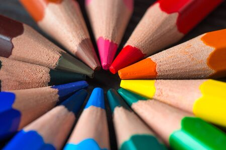 close-up shot of a group of colored pencils arranged in a circle