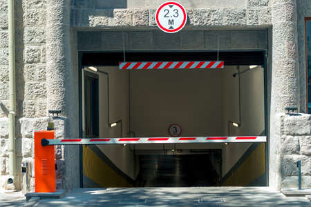 barrier at the entrance to the underground parking of the shopping center