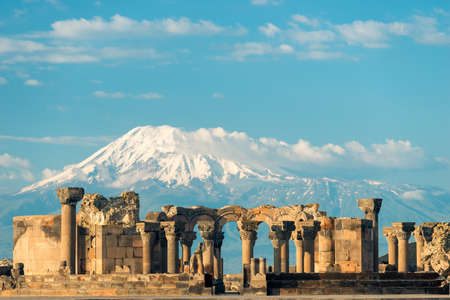 View of Zvartnots Temple on the background of Mount Ararat - a tourist attraction of Armenia