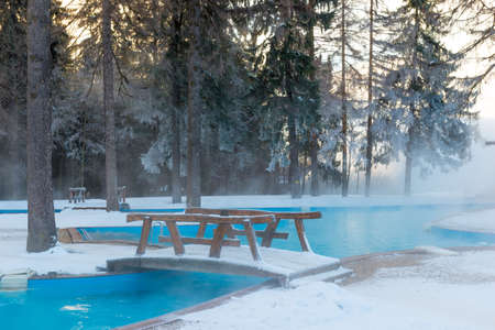 Open-air swimming pool with warm water in winter