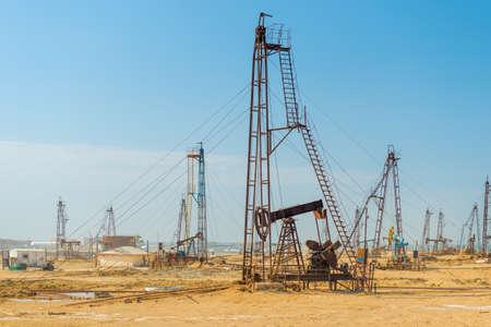 Pumping unit as the oil pump installed on a well. Equipment of oil fields Azerbaijan Standard-Bild