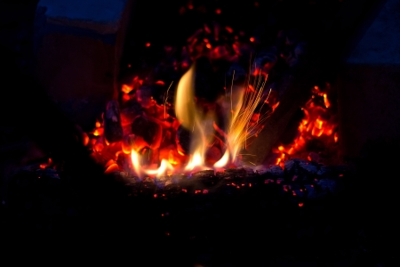 Fire flames raising in a dark background Stock Photo - 17994826