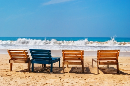 Sea view, wood chairs on the beach photo
