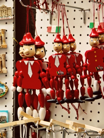 Funny souvenirs wooden Pinocchio marionettes and magnets from Rome, Italy photo