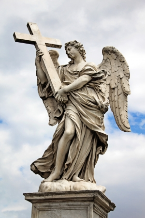 angel statue: One of the angels  with cross  at the famous Sant Stock Photo