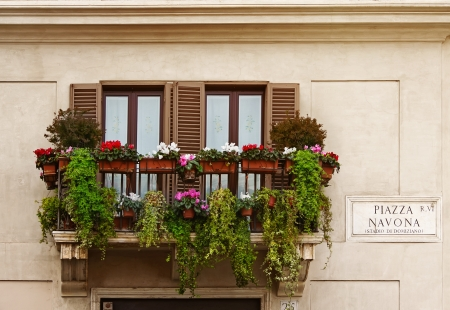 Balcony with flowers on Piazza Navona - one of the most famous squares in the world, and the most famous in Rome, Italy   photo
