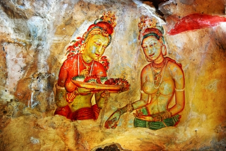 ancient fresco depicting two maiden with fruits on the ancient rock fortress Sigiriya, Sri Lanka. Sigiriya ( Lions rock ) is a large stone and ancient palace ruin in the central Sri Lanka photo